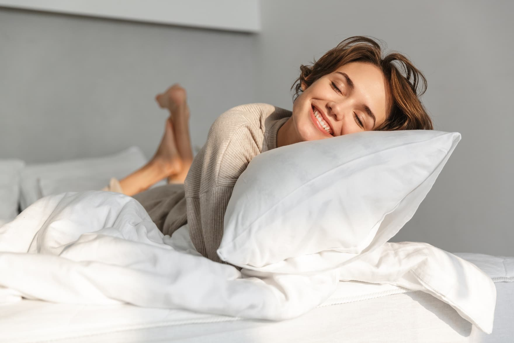 11 Tips For A Comfortable Night's Sleep. Comfortable bedding in the gray colored bedroom