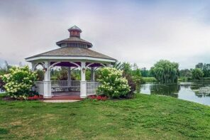 Top Factors to Consider When Creating a Landscape Design. Large multilayered roof pergola at the lake shore with roundish forms