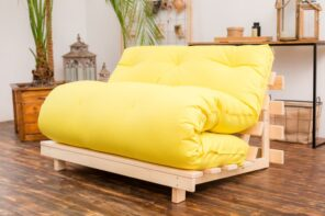 Differences Explained: The Ultimate Futon vs. Bed Comparison. Yellow minimalistic sofa on the wooden frame