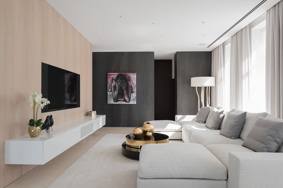 Turning Your Home into Heaven - Smart Ideas to Make it Happen. Dark accent walls and wooden trimming for multimedia surface in the large modern styled living room with neat white furniture