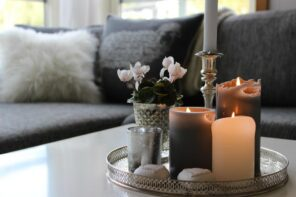 Turning Your Home into Heaven - Smart Ideas to Make it Happen. Cozy Scandinavian interior with fluffy cushions and candles on the tray