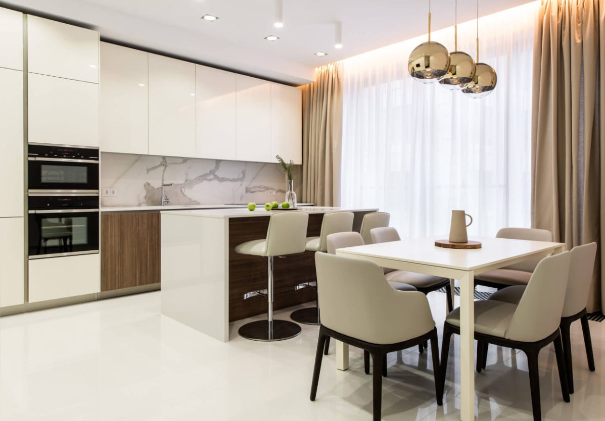 How Can Kitchen Remodeling Boost Your Property's Value in Utah. White pastel colored modern kitchen with dining zone and bar counter