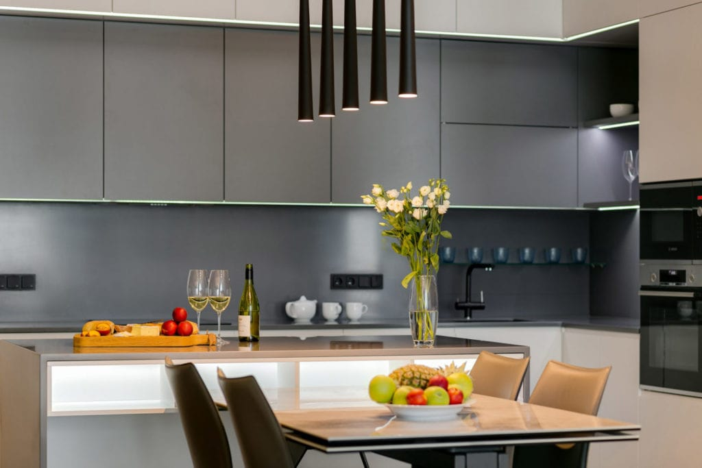 How Can Kitchen Remodeling Boost Your Property's Value in Utah. Great modern designed kitchen with table and 5 tube lamp chandelier over it