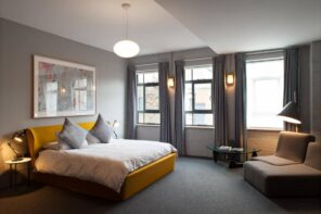 4 Tips to Help You Make the Most of Your Home Remodel. Noble and cozy gray colored bedroom with carpet