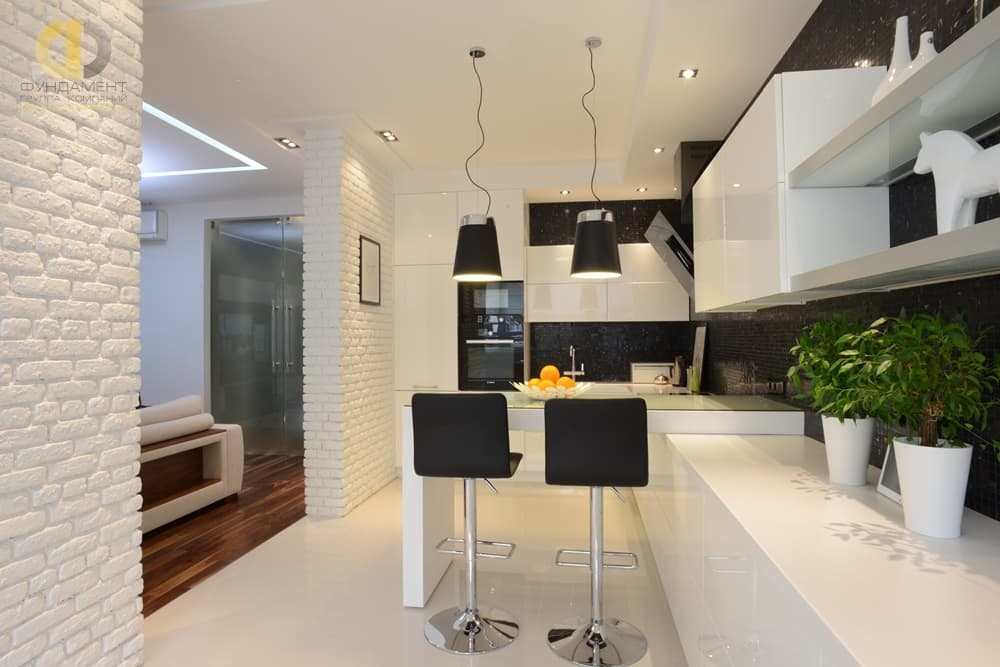 4 Tips to Help You Make the Most of Your Home Remodel. great pastel white colored modern kitchen with brickwork imitation and glossy plastic surfaces of the furniture