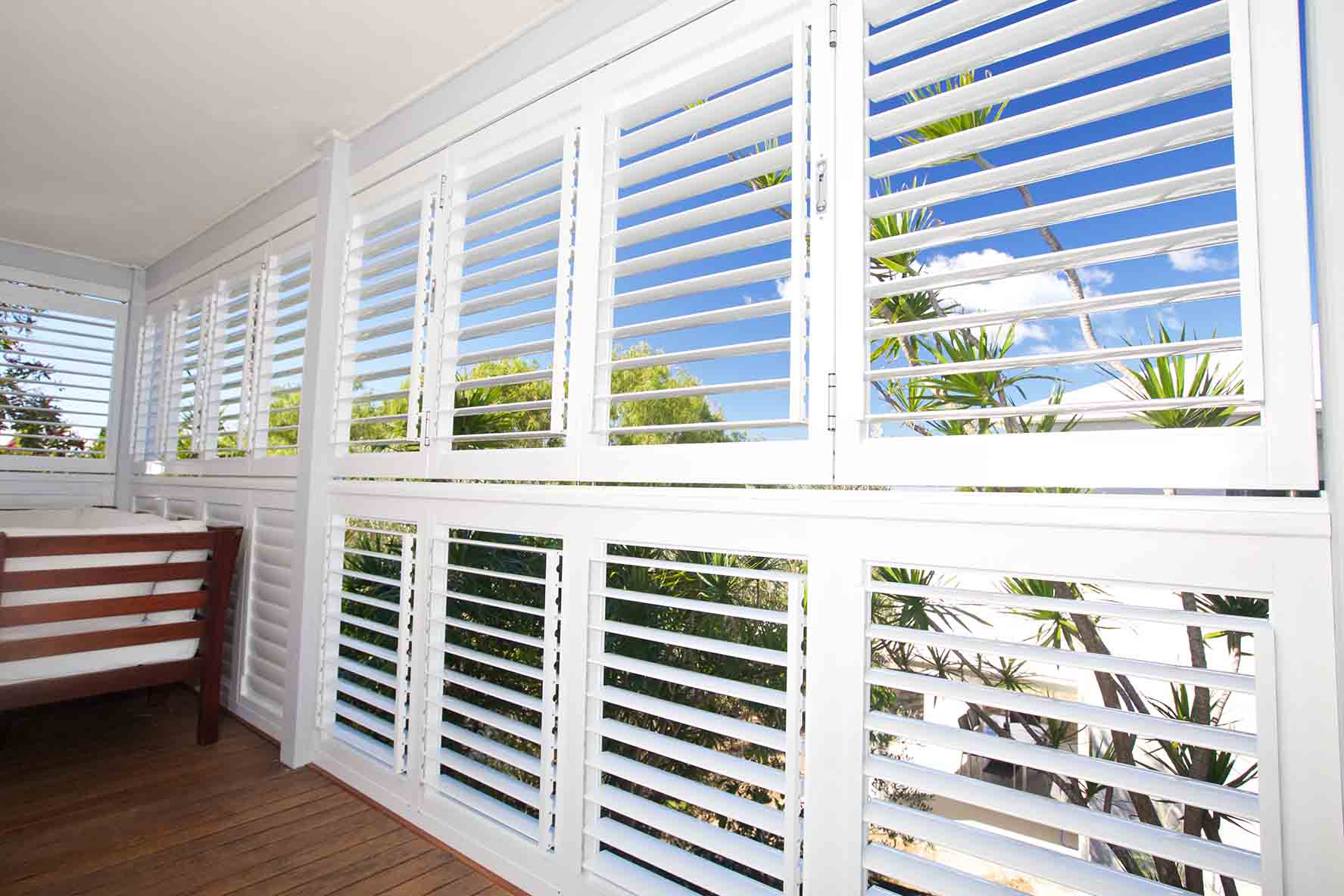 How to Buy the Right Plantation Shutters for Your House. Nice view out of the window with white shutters