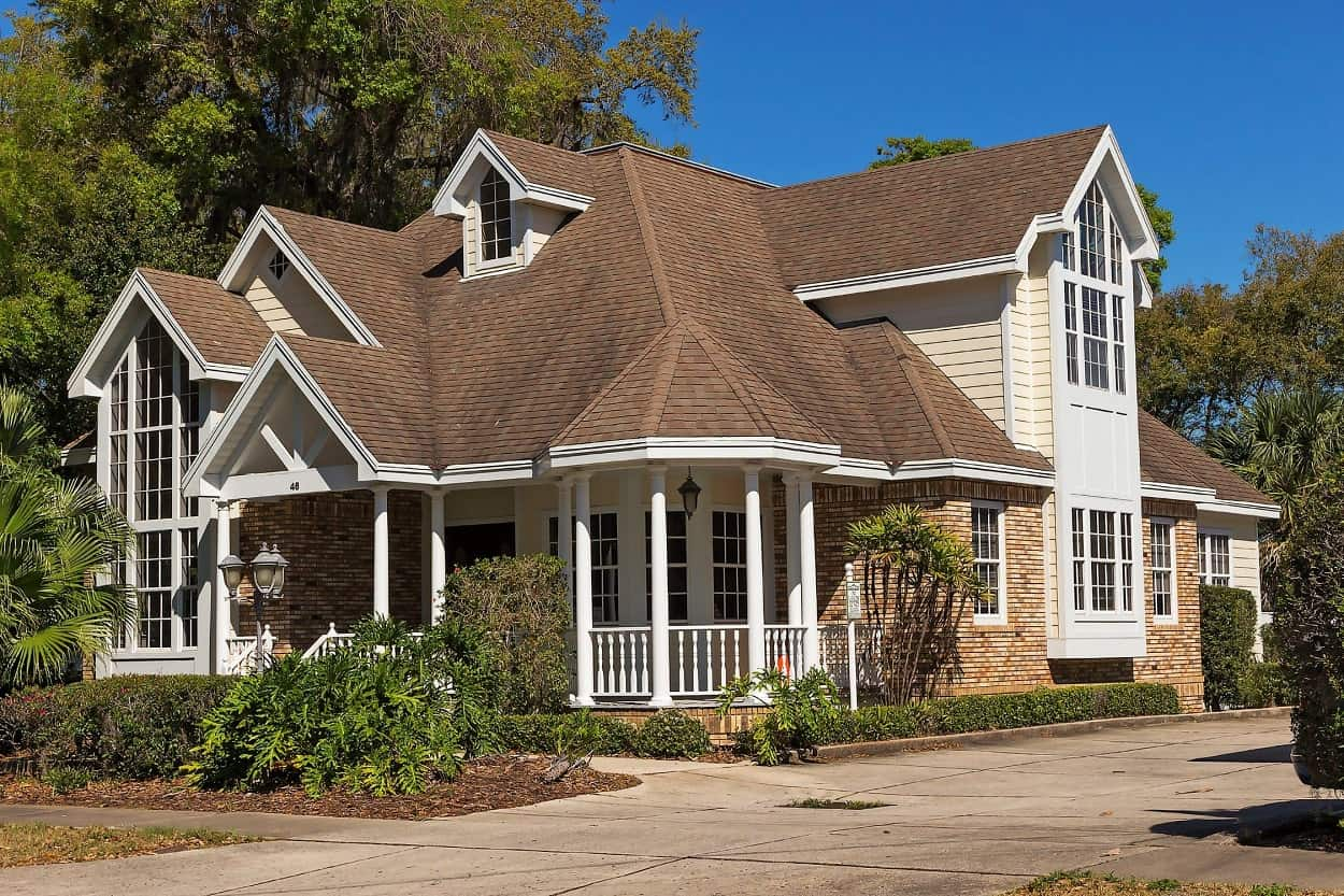 Ambler Roofers Answer - Avoid These Five Mistakes When Choosing a Roofer. Classic English colonial styled house with low porches and complex gable roof