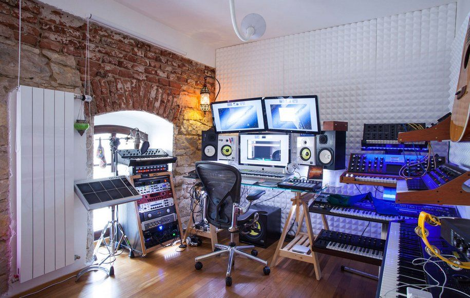 How to Design a Functional Home Music Studio. Light interior with accent brickwork wall and whitewashed texture for casual styled space