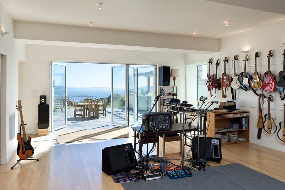 How to Design a Functional Home Music Studio. Open space oceanside view of the mansion with light colored interior design
