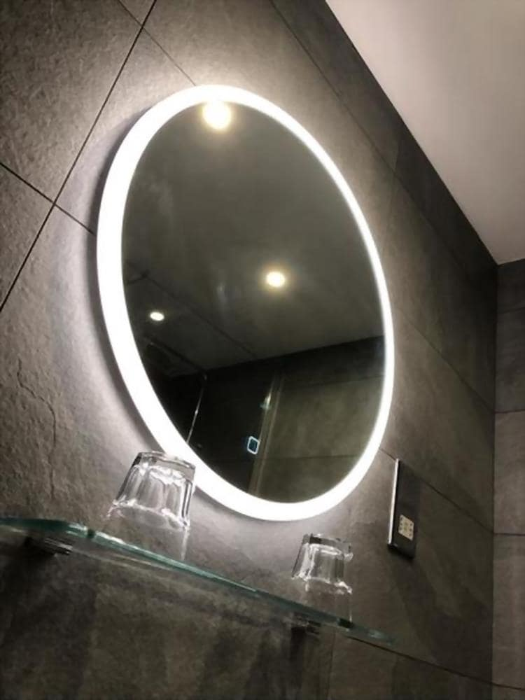 LED Vanity Mirror: The Best Source of Brightness to Design an Elegant Looking Bathroom. Round mirror with perimeter lighting for faux concrete tiled space