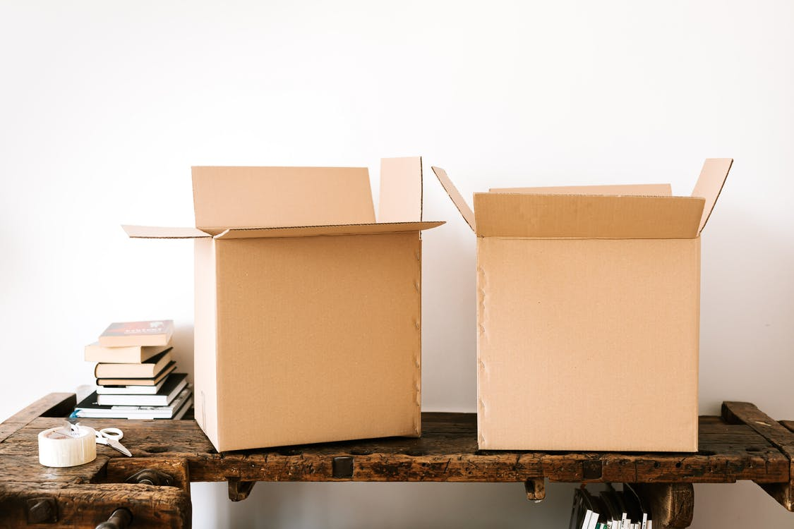 Five Tips To Organize Your New House. Cardboard boxes with personal things of new homeowners