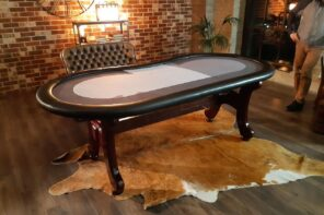 Placing Poker Tables in Small Spaces. Small table for large living room to take up less area. Classic table with wooden legs