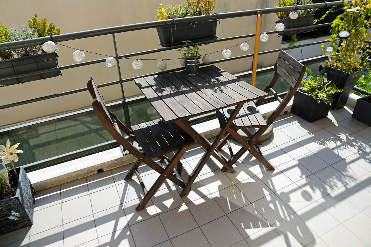 4 Tips For Choosing The Right Balcony Furniture. Great black wooden furniture set with the table and foldable chairs for open balcony