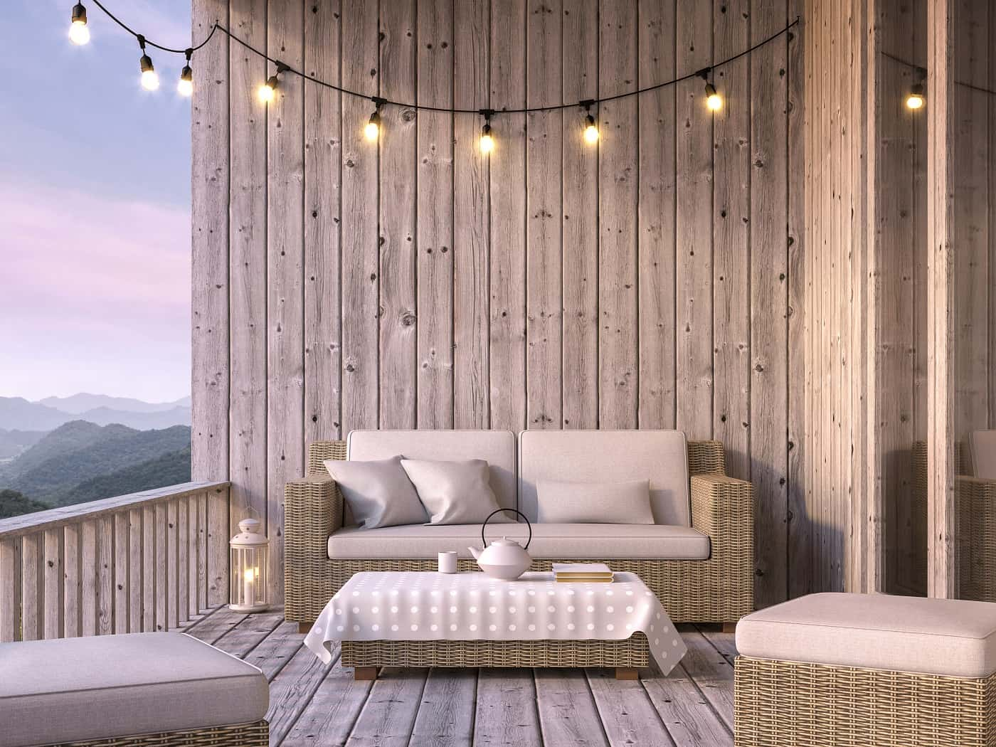 4 Tips For Choosing The Right Balcony Furniture. Rattan furniture set, classic bulb lamp strip and wooden planks wall trimming make the interior authentic