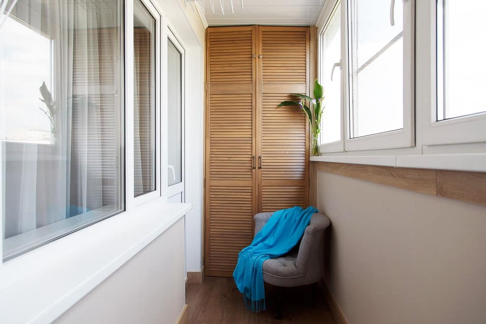 Nice modern designed balcony with wooden cabinet and light decoration