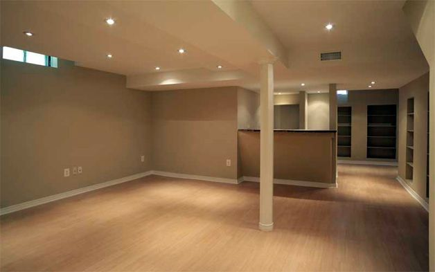 Five Highest ROI Basement Renovation Projects. Business space with light wooden laminate at the ground floor