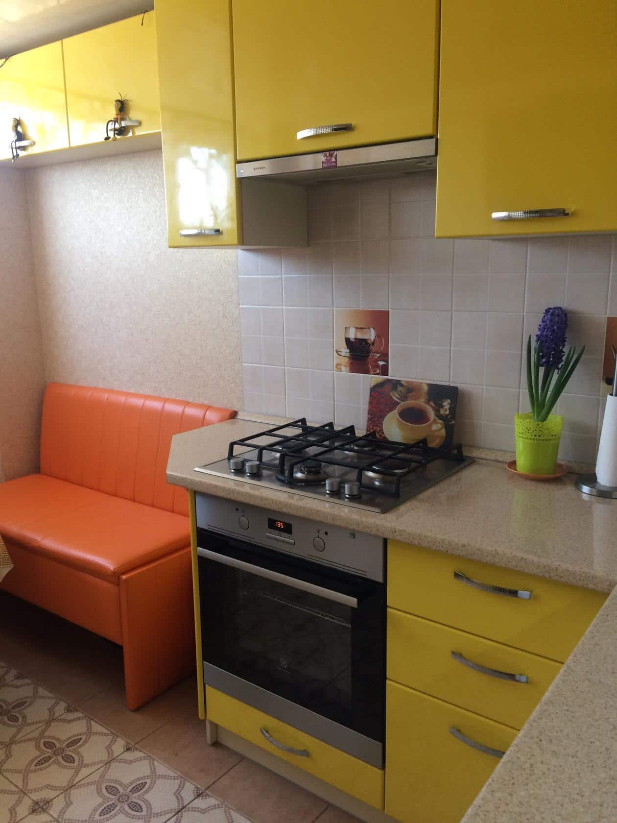 Pros and Cons of Small Kitchens. Yellow furniture set and orange seat for colorful designed space