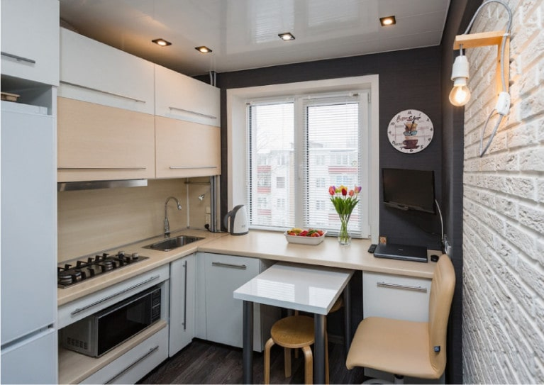 Pros and Cons of Small Kitchens. Dark painted walls and glossy tops
