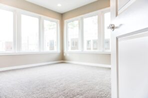 6 Tips To Choosing The Right Flooring. Nice looking modern staged apartment with carpeting and light beige walls