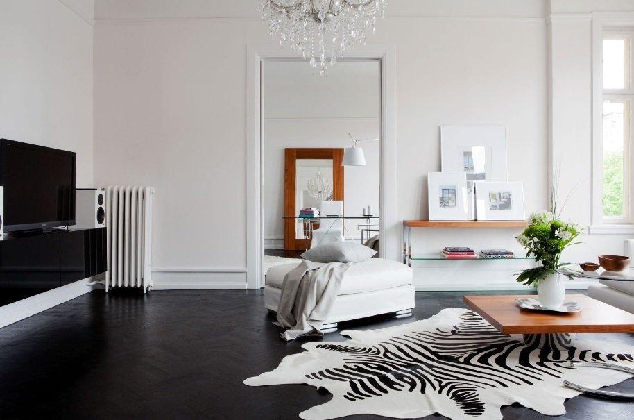 White Wallpaper Interior Design Ideas. Unusual casual design with black floor and zebra pelt