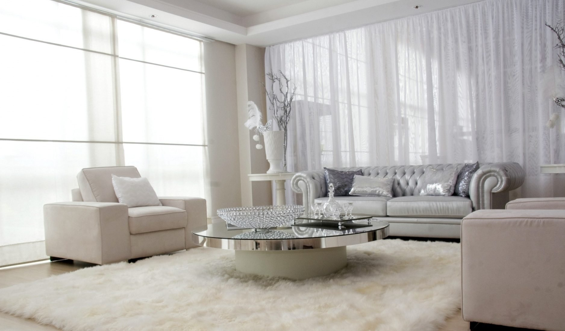 Fluffy floor living room design with white walls and creamy furniture