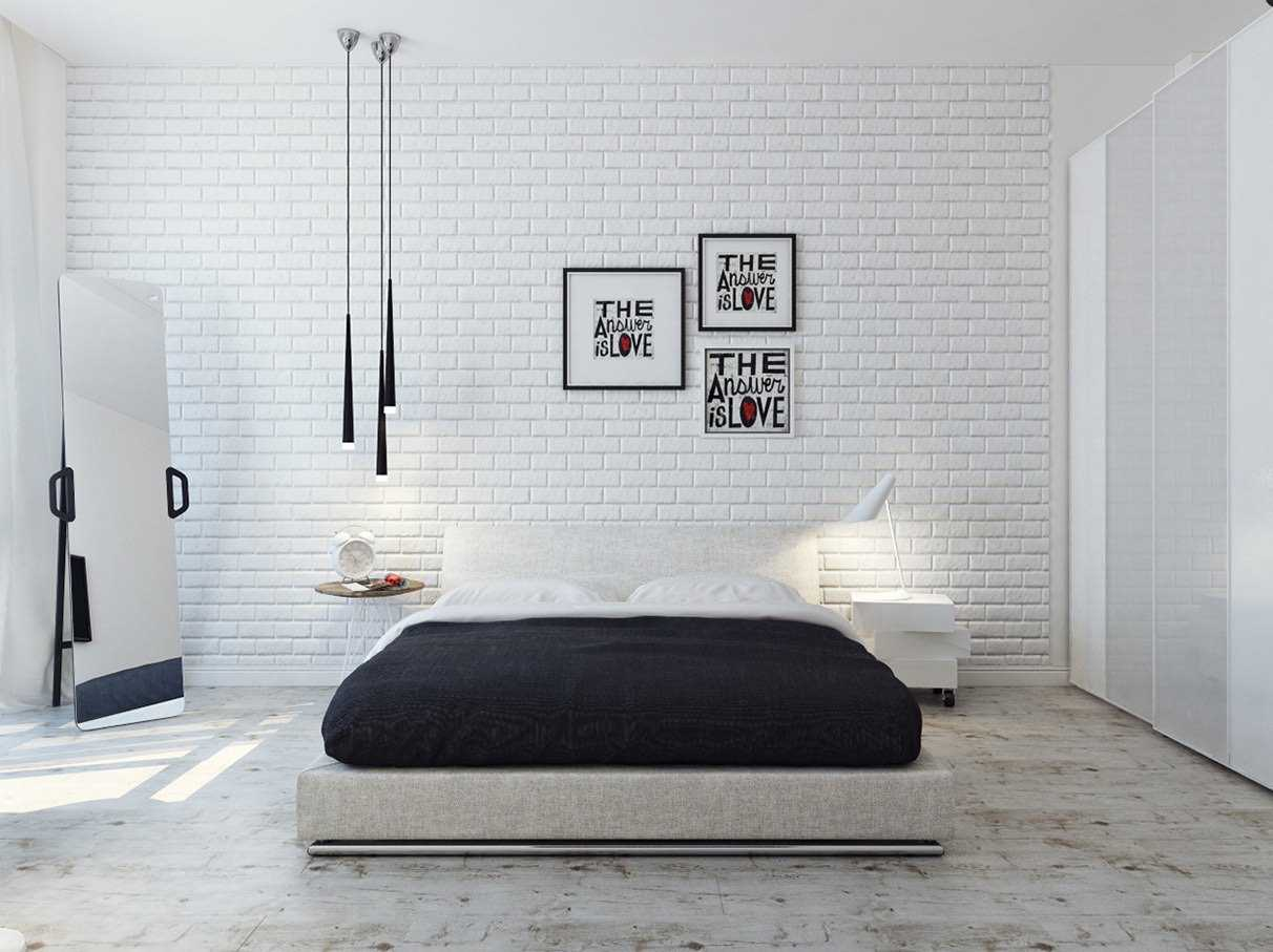Platform bed with dark mattress and whitewashed wall along with dark three-lamp chandelier