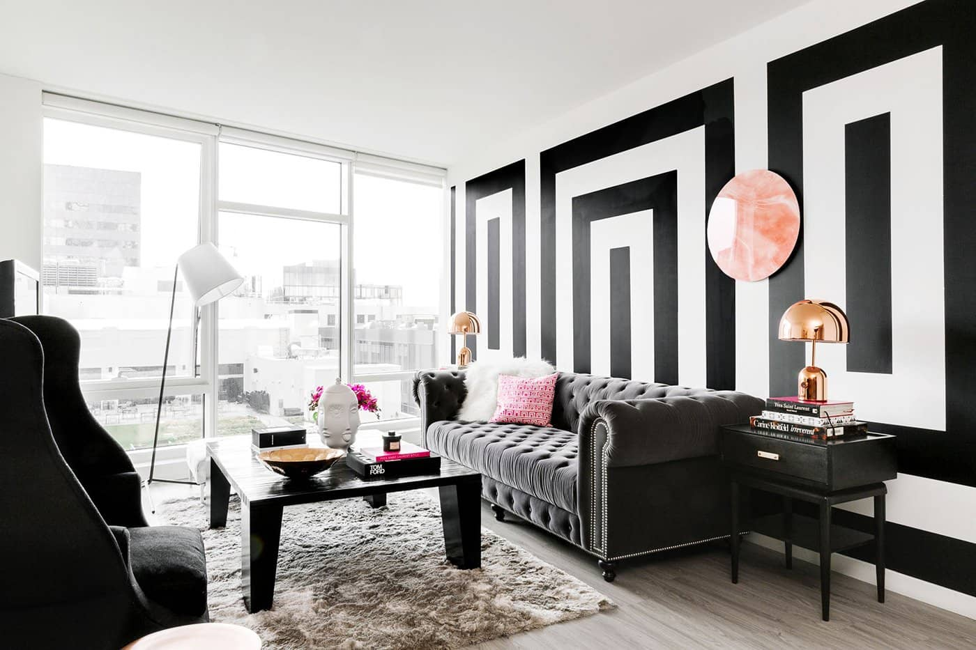 Vintage designed living room, panoramic window and black colored furniture