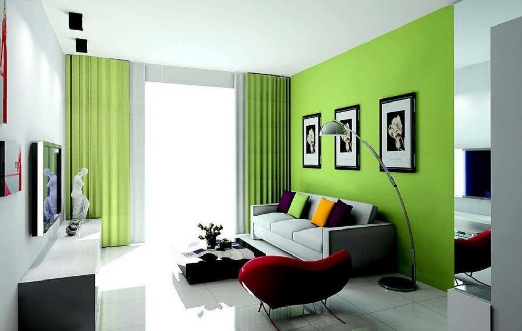 Green colored accent wall and white wallpaper on the rest of the walls for the living room