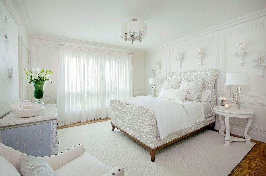 Pastel colored bedroom with large tulled window
