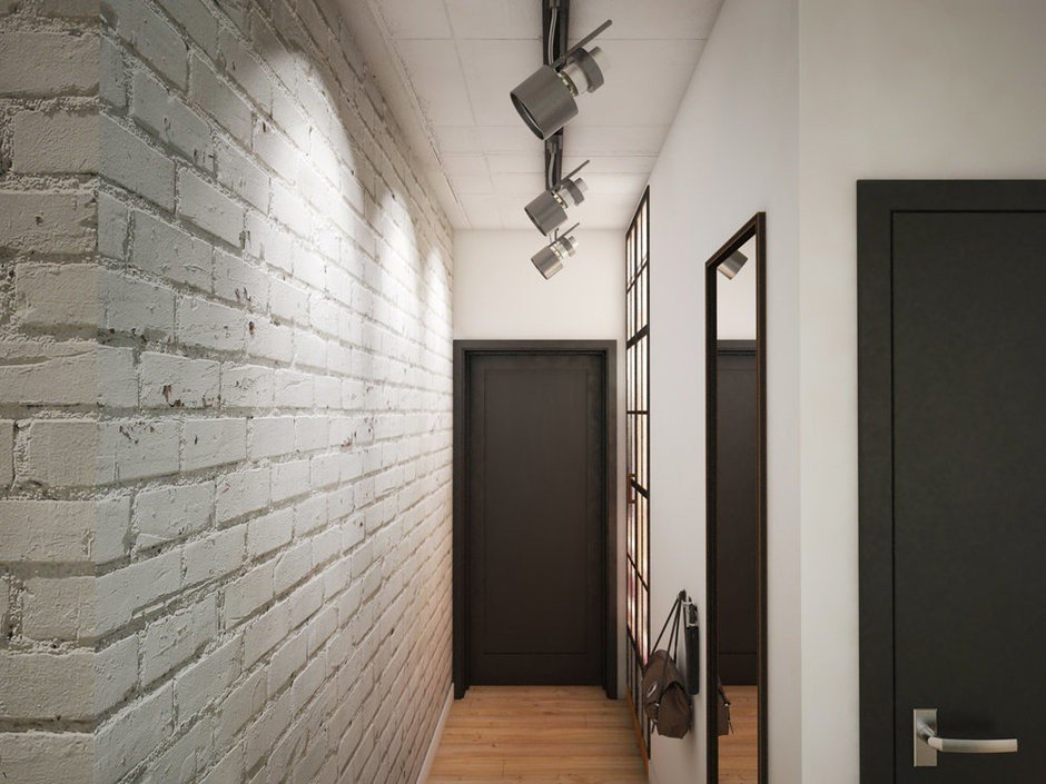 Nice adjustable direct lighting on the rod and loft touch of the narrow corridor in the form of whitewashed brick wall