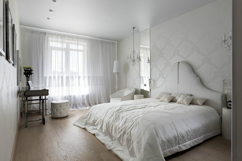 Light wooden laminate an show-white bedroom setting along with silk bedding makes it unrepeatably cozy