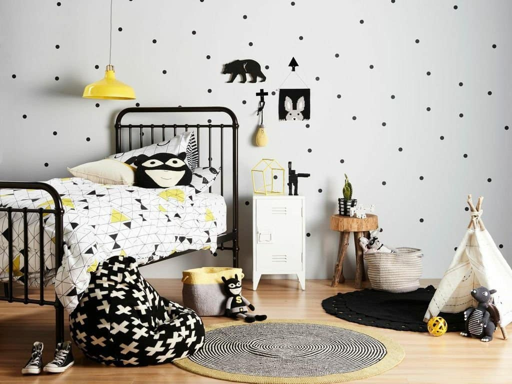 Dotted wallpaper and black-white accents all over the children's room