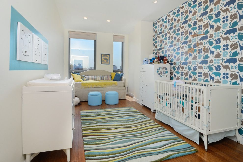 Accent colorful wall for white colored kids' room full of necessary furniture