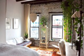 7 Methods for Eco-Friendly Home Renovation. Loft interior with rough whitewashed wall, simple wooden shelving with plants and overall casual design in light pastel colors