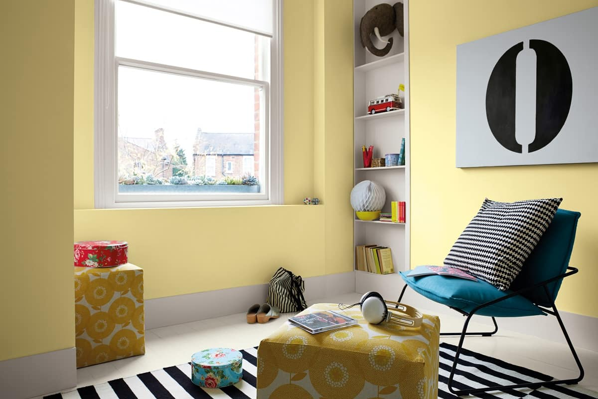 7 Methods for Eco-Friendly Home Renovation. Yellow designed children's room interior with striped contrasts