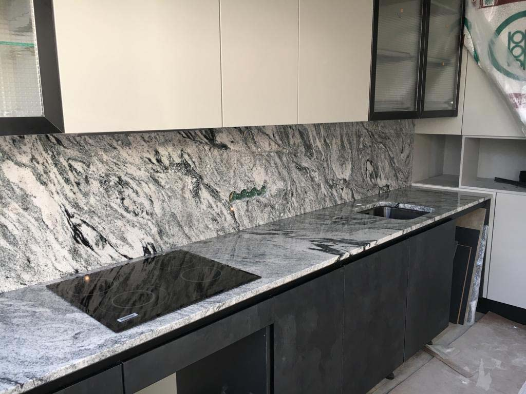 A Guide To Using Granite In Your Kitchen. Great casual interior design with backsplash and countertop in the same structure of marble imitating slabs