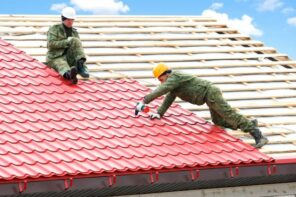 10 Reasons Why a Local Roofing Company is Best. Two workers are laying metal tile roof