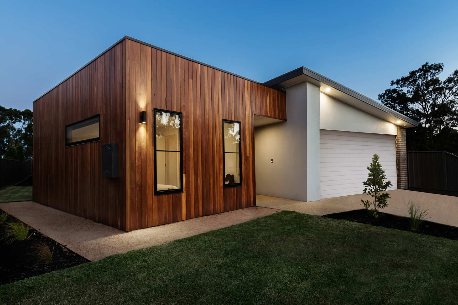 15 Outside Lighting Ideas To Brighten Your Home. Modern wooden trimmed exterior and whitewashed other part of the house