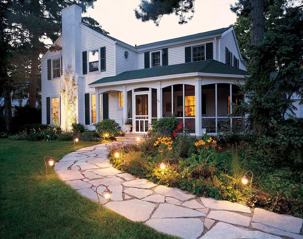 Neat Classic styled house interior in white with paved enlighted walkways