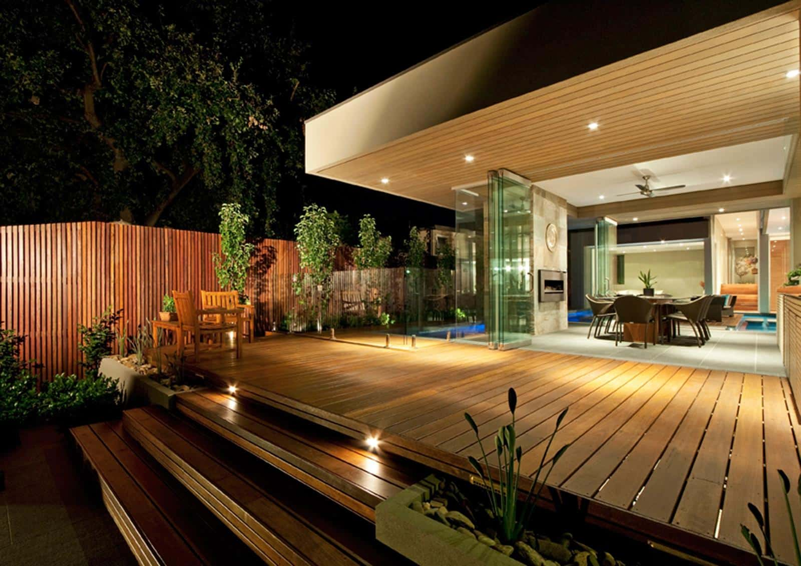15 Outside Lighting Ideas To Brighten Your Home. Deck lighting of the wooden trimmed house