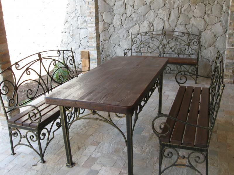 Best Patio Furniture Materials For The Hot Season. Wrought iron and wooden topped set for the BBQ zone in casual style