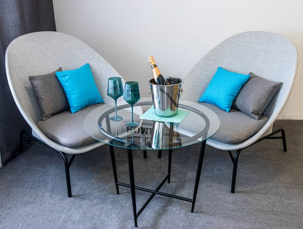 Best Patio Furniture Materials For The Hot Season. Nice compact set of two round form stools and the table on black legs