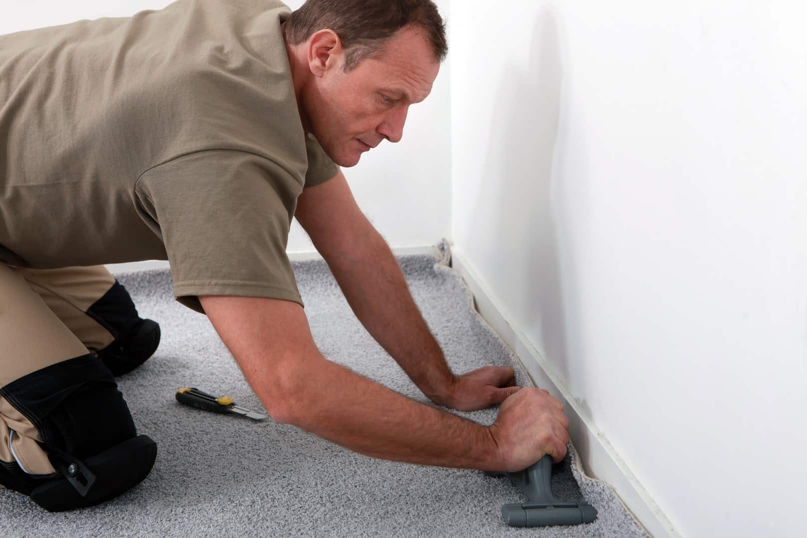 6 Tips For A Smooth Carpet Installation. Leveling the edges of the carpet at the walls with the soft spatula