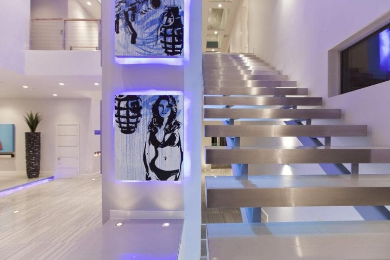 Ways for Using LED Strip Tapes. Silver plated stairs in the chic interior backlit with light