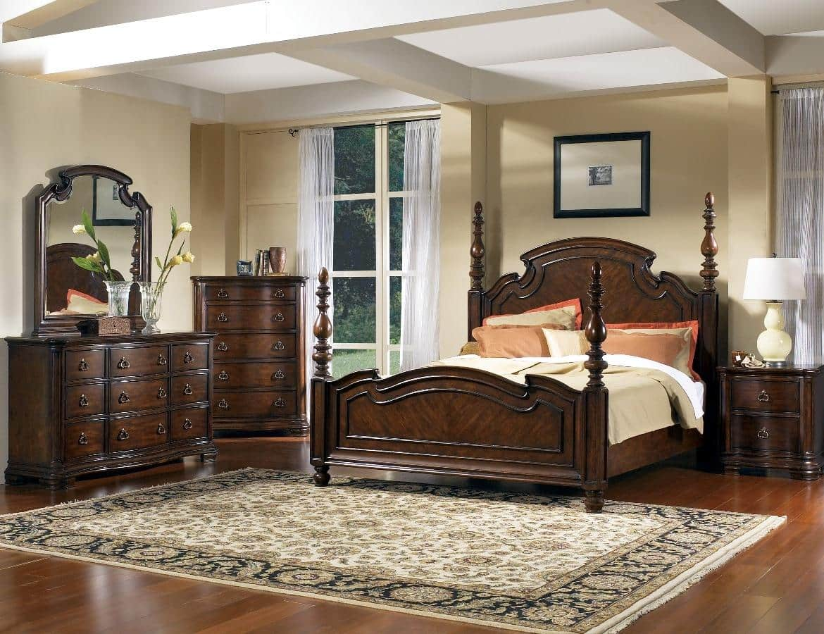 Classic carved wooden bedroom furniture in dark noble hues