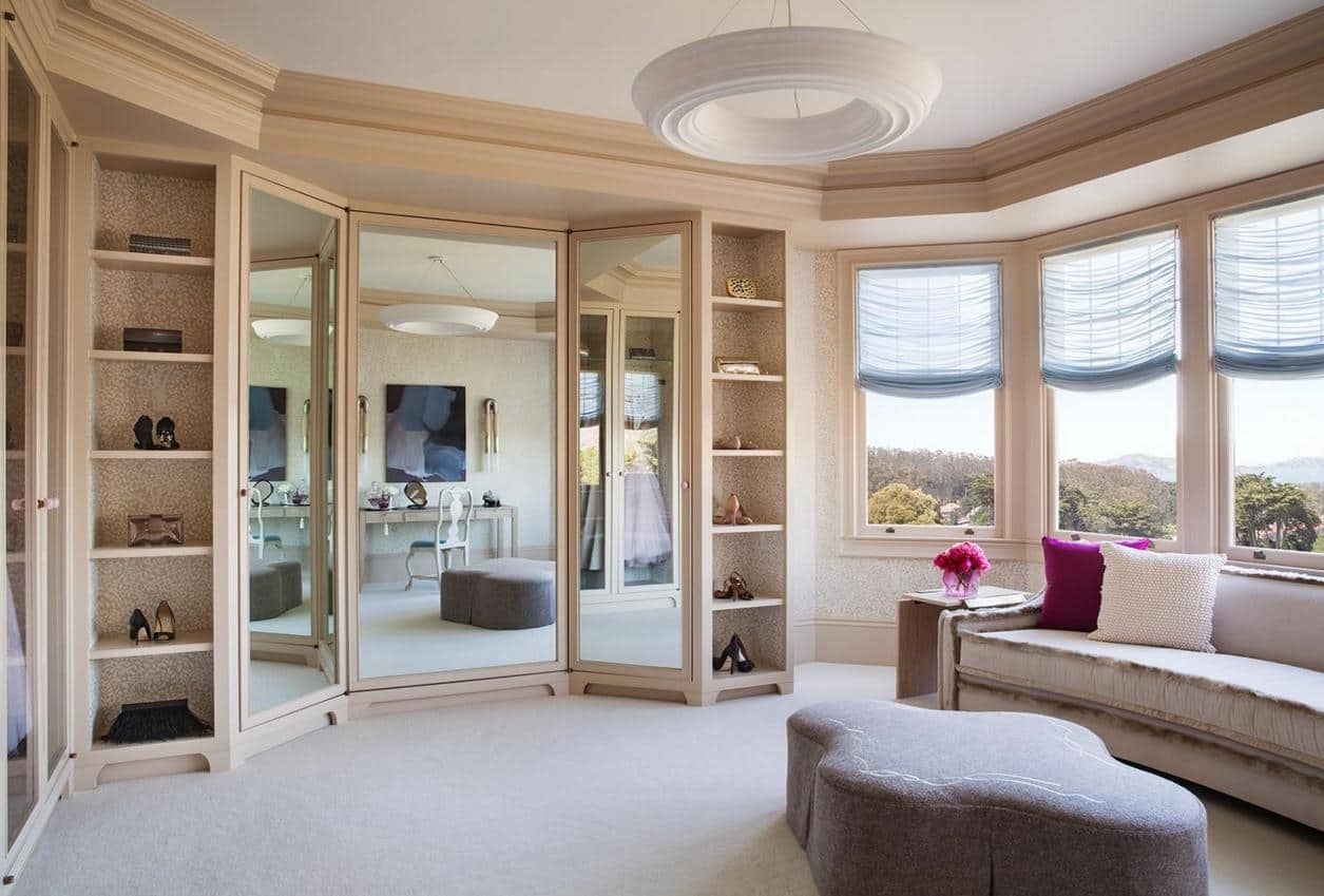 Nice feminine wardrobe and boudoir space in pastel colors with large windows