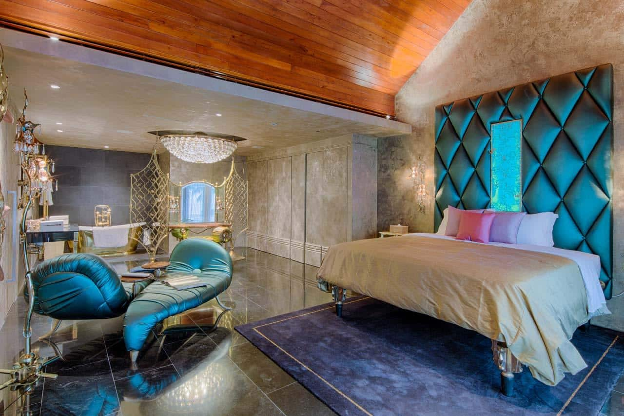 Fusion boudoir interior with rich contrasting decoration and stunning marble wall finishing
