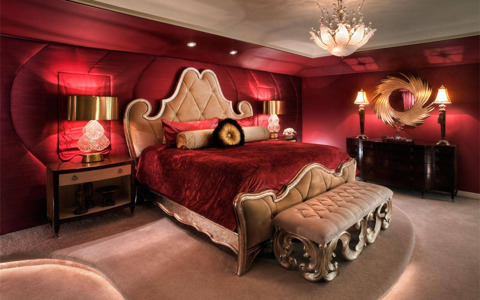 Burgundy colored bedroom with royal chic soft headboard