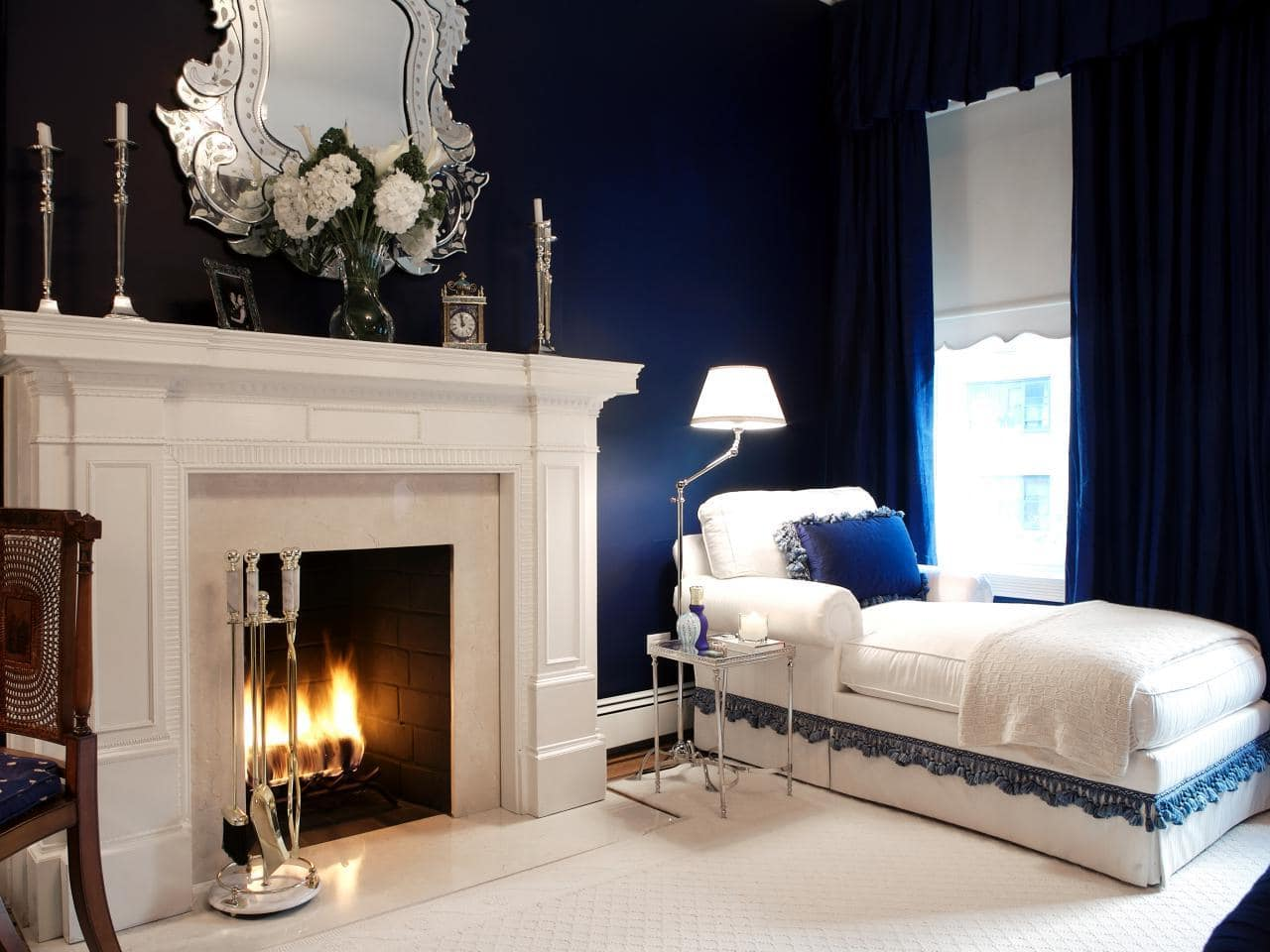 Blue colored walls and white stucco fireplace