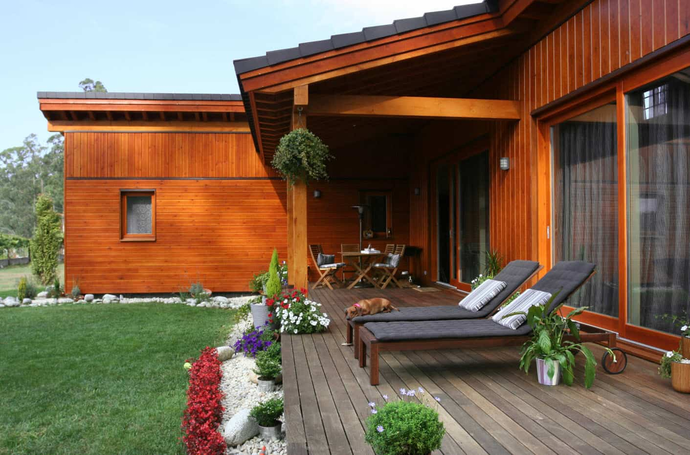 Don't Move, Improve: Easy Ways To Change The Look And Feel Of Your Old Home. Backyard decking with sunbeds and flowers